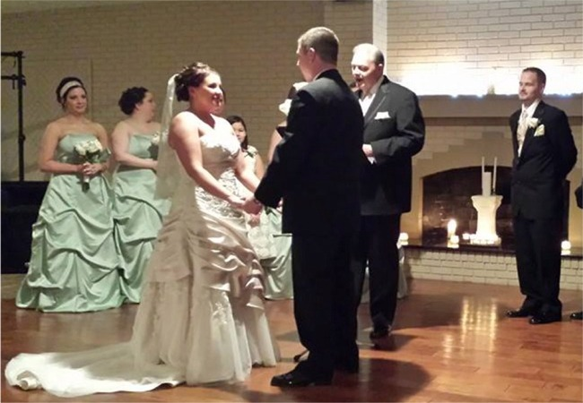 Abi and Brian exchanging vows